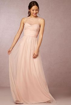A long, blush pink bridesmaid dress | @amsalemaids | Brides.com