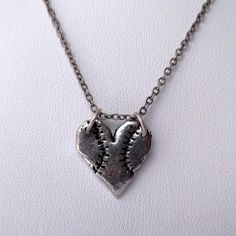Take Me Out To The Ball Game Heart Shaped Baseball Charm Pendant Necklace on Antiqued Silver Chain. $28.00, via Etsy.