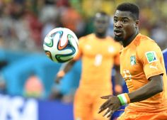 Ivory Coast's defender Serge Aurier eyes the ball during a Group C football match between Ivory Coast and Japan at the Pernambuco Arena in Recife during the 2014 FIFA World Cup on June 14, 2014.
