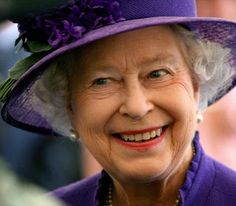 Queen Elizabeth II. This is a great pic. She almost looks mischievious. Could it be so?