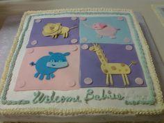 Animal themed baby shower cake for boy or girl