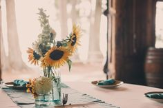 We love sunflowers in vintage vases