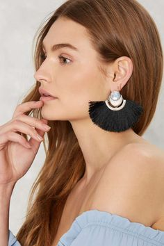 Do you even have to ask? The Big Fan Earrings feature silver hardware with a moonstone gem at ear, black thread fringe in a half-circle at bottomm, and post back closures.