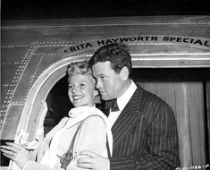 """Rita Hayworth and Orson Welles board the plane in Los Angeles that will take them to Acapulco, Mexico, for location shooting for """"The Lady from Shanghai"""""""