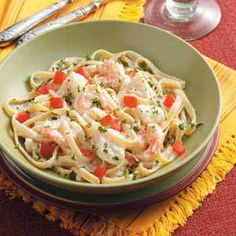 Seafood Fettuccine Alfredo Recipe -Jimmy Spellings of Oakland, Tennessee likes to serve this lovely pasta, featuring scallops and shrimp, with crusty Italian bread. Sprinkled with tomato and parsley, this dish looks as mouthwatering as it tastes. Seafood Fettuccine Alfredo Recipe, Fettucine Alfredo, Seafood Pasta Recipes, Fish Recipes, Shrimp Fettuccine, Recipies, Yummy Recipes, Healthy Recipes, Seafood Dinner