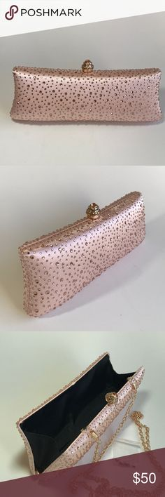 🎉Brand new sprarkly clutch🎉 Sparkly clutch with diamanté clasp. Color is rose gold with clear crystals. iPhone 6/7 can fit in with room for other essentials. Fully lined with detachable chain strap and additional crystals. Approximate measurement: 9.5in x 3.5 in x 1.5 in. Detachable strap has a hang length of 24in and is a standard length for crossbody. Available in gold, silver, Black with silver stripes and silver with black stripes. Please see other listings.www.kiarapurse.com. Kiara…