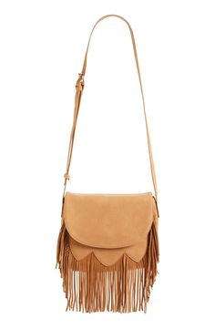 Swingy sueded fringe adds to the easy boho charm of this curved-flap crossbody bag in pebbled-faux leather.