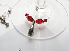 Wine glass charms by Exhaustedcreativity on etsy $18.00 for set of 8