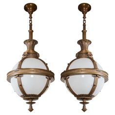 Monumental Pair of Pendant Globes or Orbs from Railroad Station, circa 1910 | From a unique collection of antique and modern chandeliers and pendants  at https://www.1stdibs.com/furniture/lighting/chandeliers-pendant-lights/