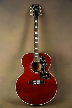 Here we have a 1999 Gibson in the super rare Wine Red finish! This guitar features a Sitka Spruce top with flamed maple back and sides. Acoustic Guitar Kits, Gibson Acoustic, Gibson Guitars, Guitar Chords For Songs, Music Guitar, Cool Guitar, Learn Guitar Online, Rare Wine, Guitar Photos