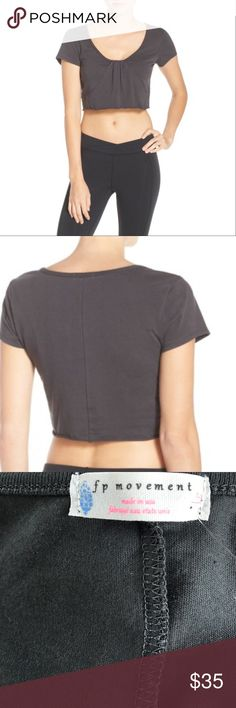Free People Start It Up Crop Top NWT, never worn! Perfect comfy shirt. Color: Dark Grey A swooping scoop neck and flouncy silhouette style a lightweight crop top perfect for staying cool and comfortable at your next barre class. - Scooped neck - Short sleeves Free People Tops Crop Tops