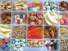 To package snacks for traveling kids, use a tackle box or craft organizer box and fill each compartment with something different (fruit snacks, dried fruit, nuts, candies, crackers, roasted chickpeas, popcorn, baby carrots, etc.).