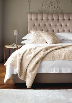 like the headboard and clean, simple way the bed is dressed