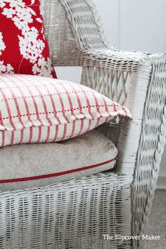 Washed linen seat cover for a vintage wicker chair. Cottage living at it's best!