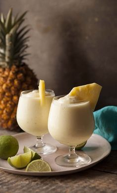 Frozen Pineapple Daiquiri. Fresh pineapple chunks (half frozen, half unfrozen), crushed ice, sugar syrup, white rum. ..and juice of one lime. Cheers:)