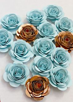 Baby Blue & Gold Paper Flowers  Each flower is lovingly made by hand. Just like in nature no two flowers are identical which adds to the charm! Flowers are made out of high quality acid free paper and are super sturdy. They will last you for many years to come. The possibilities are truly endless for these paper flowers!  Use them as party decor, nursery decor, as table confetti, place settings, cake decorations, gender reveals, photo shoots, wedding decorations, or to add a special touc...