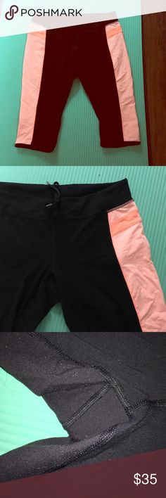 Euc 10 Lululemon  Short/crop Can't remember the name of this style but it is supposed to hit above the knee a bit, like a biker short. I'm pretty sure they are a 10 but I couldn't find a dot so I provided waist measurements. Please see that photo and photo that  shows piling otherwise no flaws! Black with salmon pink stripes on sides. lululemon athletica Pants Ankle & Cropped