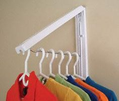 """The InstaHanger expands to 12"""" of instant clothes storage and closes to only 1-1/4"""" when closed. It holds an impressive 50 lbs. load capacity. Use for hanging damp or wet clothing or anytime extra hanging space is needed. Cleans easily with a damp cloth. Easy installation and key hole screw slots allow for quick relocation."""