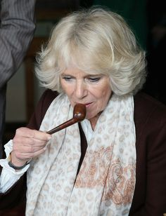 Camilla, Duchess of Cornwall smells Rudyard Kipling's pipe as she sits at his desk during a visit to Bateman's, the East Sussex home of the author, on March 19, 2014 in Burwash, United Kingdom. Bateman's was the secluded family home of the author, who wrote 'Jungle Book' and 'If'.