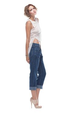 Dress up your boyfriend jeans with a slinky silk top and nude heels