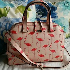 """Kate Spade Flamingo This purse is a total must have! Gorgeous flamingo watercolor print.  Lovely vibrant colors. Perfect for this Spring and Summer Season! Double zippers. Two drop handles with removeable crossbody strap. """"Kate Spade"""" print lining in a gorgeous melon pink. Interior has one zip and two slip pockets. Don't miss out on this beauty! ♡   * Matching Wallet Available * :D  NO TRADES, THANKS :) kate spade Bags Crossbody Bags"""