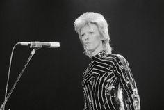 Lou- When David Bowie burst onto the scene in the early '70s in full Technicolor Ziggy Stardust Glitter Rocker Regalia– he forever changed the Rock 'n' Roll landscape, and r…