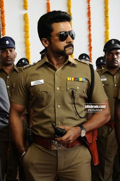"Suriya as a virile police officer with a cosmically awesome moustache in the Bollywood movie ""Singham""."