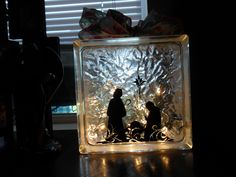 glass block with vinyl, stuffed with white christmas lights... was a relief society craft project with church!