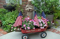 of July Decor ~ (I did something a little similar to this. But I have the real small Radio Flyer wagon and I put red, white and blue flowers, flags & of July themed picks. Mine is Indoors on the sofa table. Fourth Of July Decor, 4th Of July Celebration, 4th Of July Decorations, 4th Of July Party, July 4th, Office Decorations, Outdoor Decorations, Patriotic Crafts, July Crafts