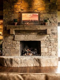 Stone fireplace with timber mantle. And how cool would that be for your ledge??