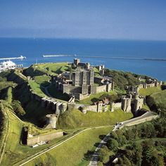 Dover Castle, Kent - one of the best castles I have visited and so much history.....used through WWII for many different purposes......there are 4 miles of underground tunnels that were used as a hospital during WWII.....built on the White Cliffs of Dover