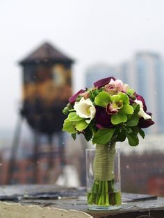 Purple, green and ivory bridal bouquet with BK watertower in background