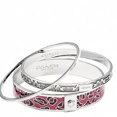 Ocelot Bangle Set Coach Ocelot Bangle Set NWT! Plated metal and packaged in a Coach gift box. Silver/cranberry. Coach Jewelry Bracelets