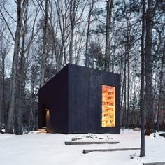 This tiny black cabin by American architects Studio Padron serves as a cozy library and guest house for a vacation home in upstate New York. via dezeen