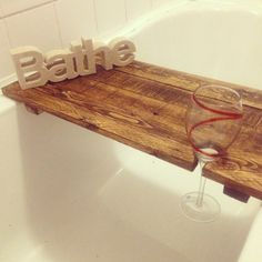 Reclaimed wood bath shelf bath tray / caddy for by JBWoodDesign Bathtub Tray, Bath Tub, Shelf Inspiration, Bath Shelf, Wood Bath, Wine Glass Holder, Easy Wood Projects, Wood Pallets, Pallet Wood
