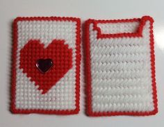 Made of plastic canvas, this gift card holder can also serve as a money holder. The center red heart is accented by a pink flat rhinestone embellishment.