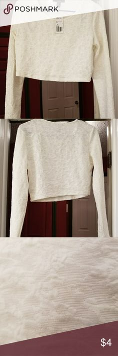 NWT Forever 21 Longsleve Crop Top Beautiful ivory top with textured pattern, 98% polyester, 2% spandex; which gives it plenty of give. Hand wash cold water. Not sheer. Forever 21 Tops Crop Tops