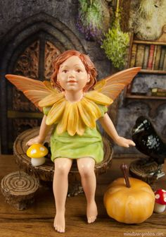 Marigold Fairy Figurine in the fall fairy garden.