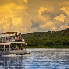 Oh #Uganda, you really are a treasure. It's no wonder why they call this land the #PearlOfAfrica. This picture on the #nileriver near #MurchisonFallsNationalPark home of our #BakersLodge.   To see our Uganda trips go to www.wildfrontiers.com today!   #nile #photography #safari #africa #eastafrica #boat #water #reflection #clouds #beauty #igers Nile River, East Africa, Uganda, Safari, Reflection, Trips, Boat, Clouds, Photo And Video