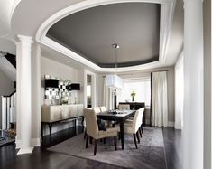 modern dining room : light fixture : color on ceiling : sideboard : lamps