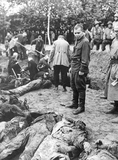 Former Russian POW Piotr Palnikov (center, in uniform) looks on as German civilians exhume the bodies of 223 Russian POWs murdered by the SS in Wurfel, Hanover, on Apr 8, 1945. Palnikov alerted the Americans of the mass grave and troops of 35th Infantry Division pressed into service locals to exhume the bodies and give them a proper burial. The local population was ordered to attend the process.Evidence of this atrocity was included in the Nuremberg Trials.