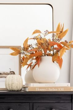 Create a simple display of fall leaves this season with faux fall stems from Afloral. Simply trim them down to fit your favorite ceramic vase and voila! Shop artificial fall leaves at Afloral.com.