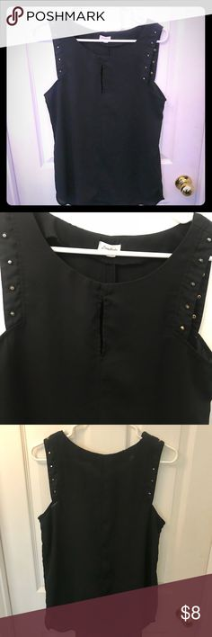 Black studded semi-sheer top Black shirt with gold studs and semi-sheer. Fashionable cut with a peek-a-boo cleavage cut out. Missing one gold stud on the back side, hard to tell if you are wearing your hair down. Size medium. Tops Blouses