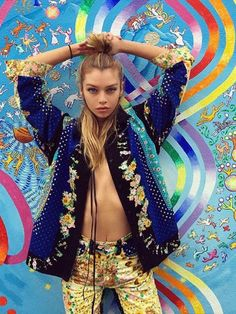 Stella Maxwell's Half-Up Style   If you can't decide between a bun or free-flowing locks, opt for a half-up 'do. The cool-girl hybrid, as spotted on Stella, feels edgier than either of those extremes—plus it works well with the texture of second-day hair.