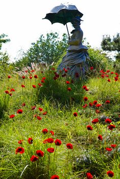 J. Seward Johnson, Jr.'s On Poppied Hill, inspired by Monet's Woman with Parasol in a Field of Poppies. Grounds for Sculpture, Hamilton, NJ.
