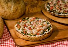 Grilled focaccia bread halves are spread with a garlic and herb cheese ...