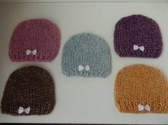 These cute little baby girl hats / baby caps have been hand knitted using a gorgeous soft sirdar softspun chunky yarn which is 53% Nylon, 24% Wool, and 23% Acrylic. These pretty hats have a light sheen to them and have been completed with little bows.  Newborn  Measures 11 around the rim Available 1 pink hat, 1 purple hat, 1 mint hat, 1 gold hat, 1 brown hat  All items are ready for next day dispatch  All items are from a non smoking home  I will combine postage for multiple purchases, j...