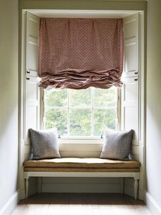 A 'London' Bind in this beautiful window in Red Hamble HAMB-001 with Cushions in Wicker N-109 and Window Seat, Figured Linen N-065