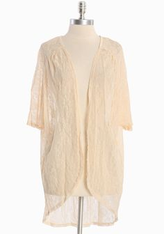 Austen Romance Lace Cardigan  36.99 at shopruche.com. This ethereal cream cardigan is perfected with sheer lace and delicate ruching for movement.  100% Nylon, Made in USA, Front 30'' length from top of shoulders,  Back 34'' length from top of shoulders