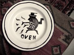 """""""Oven"""" enamel plate by Clive Hicks-Jenkins for a hand-decorated """"Hansel & Gretel"""" nursery service"""